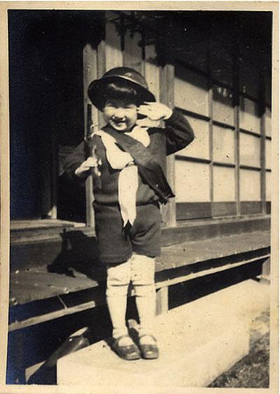 little boy saluting
